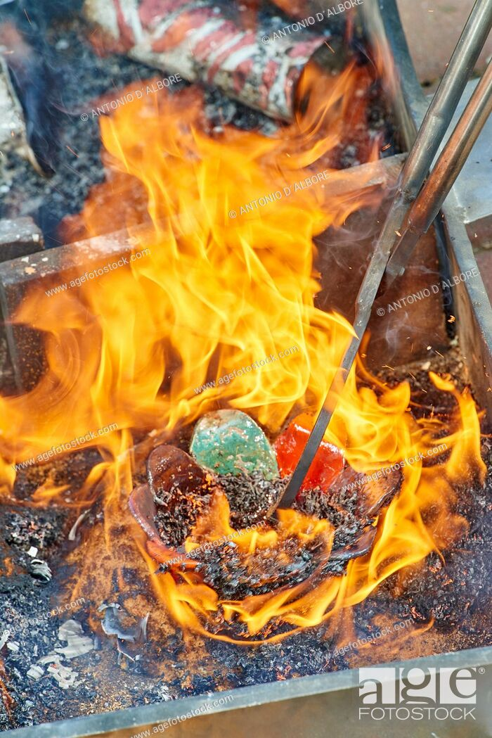 Imagen: A raku ceramic object is handled by a metallic tong after the heating process. Bovisio Masciago. Province of Monza and Brianza. . Italy.