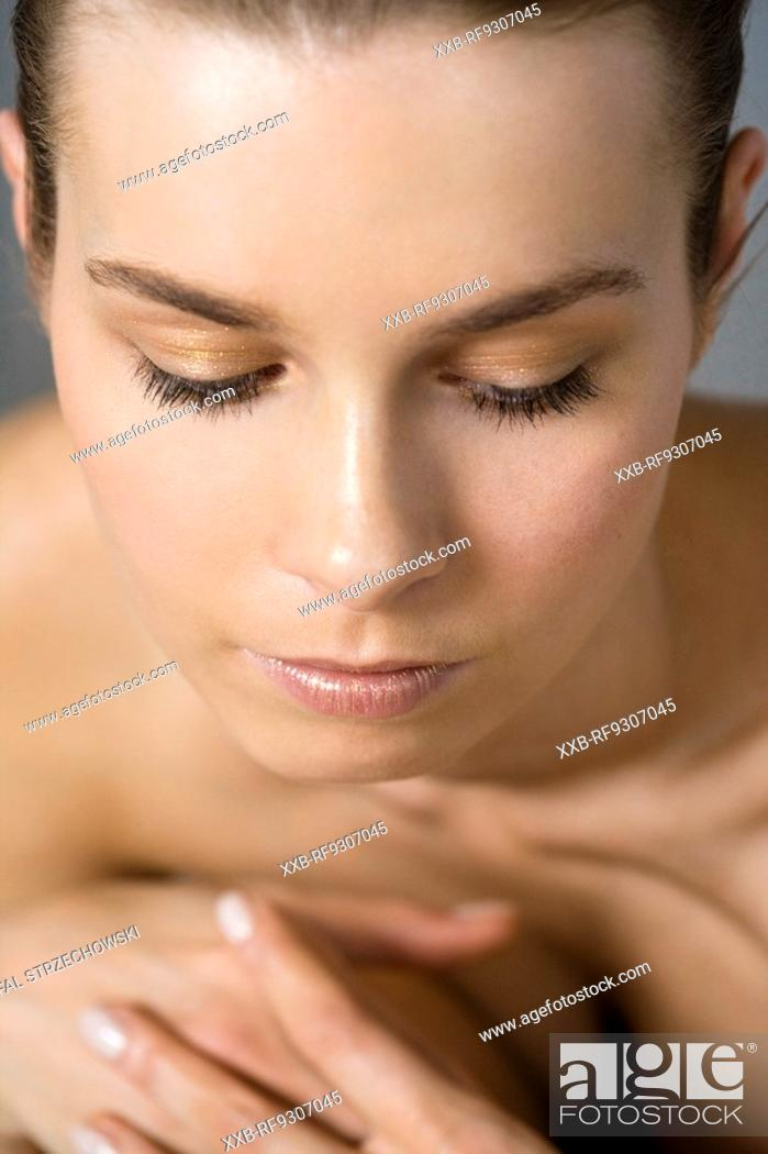 Stock Photo: woman looking down.