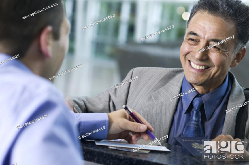 Stock Photo: Businessman checking in at airport.