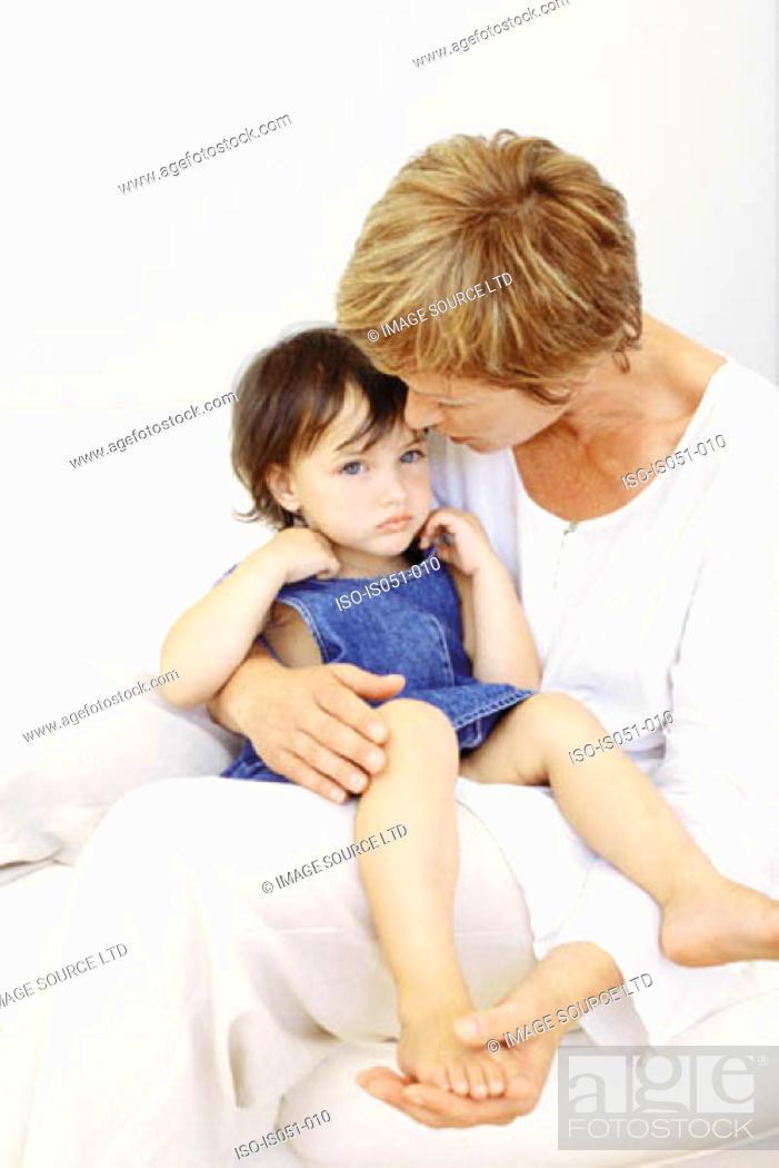 Stock Photo: Grandmother comforting granddaughter.