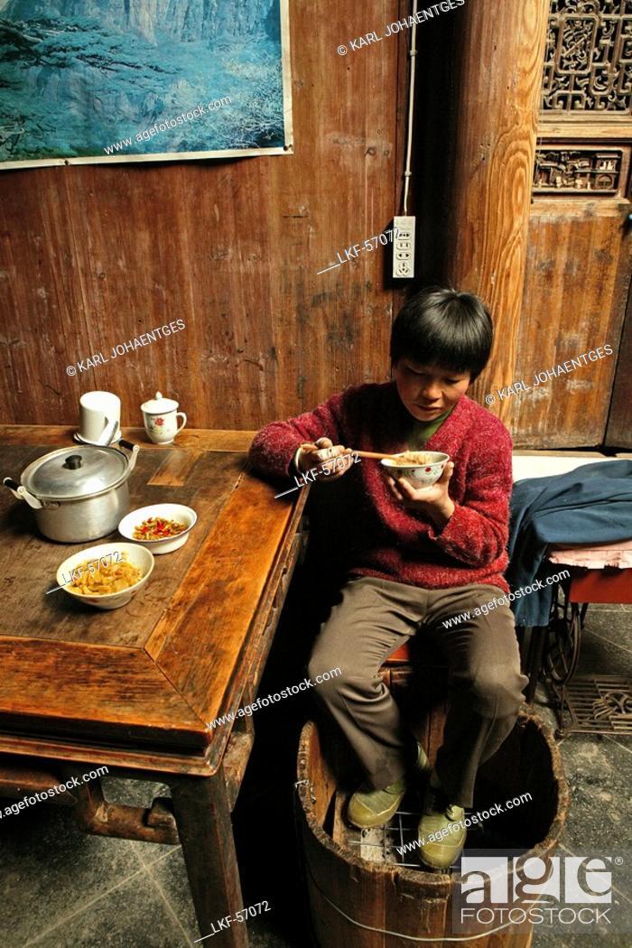 Chinese boy eats feet