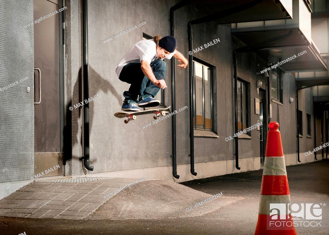 Stock Photo: Skater jumping on urban ramp.