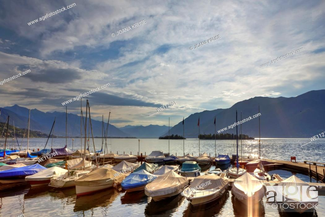 Stock Photo: The port of Porto Ronco with morning sun w ith the Brissago Islands in the background.
