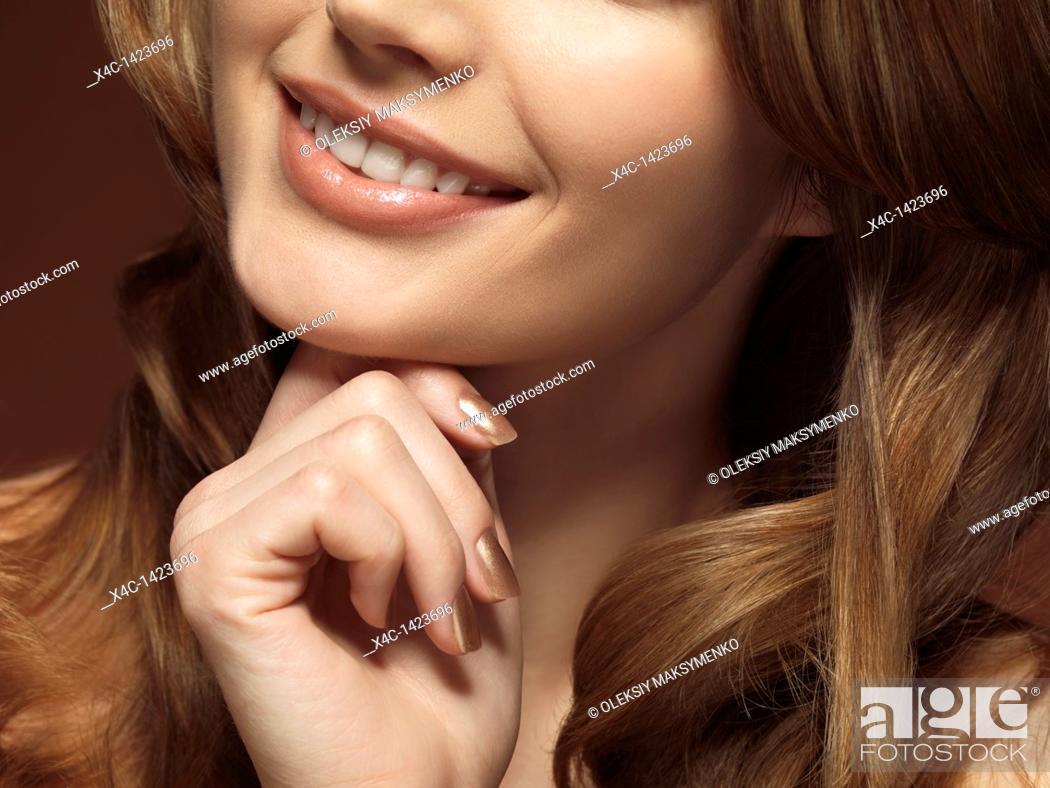 Stock Photo: Closeup portrait of a beautiful young smiling woman.