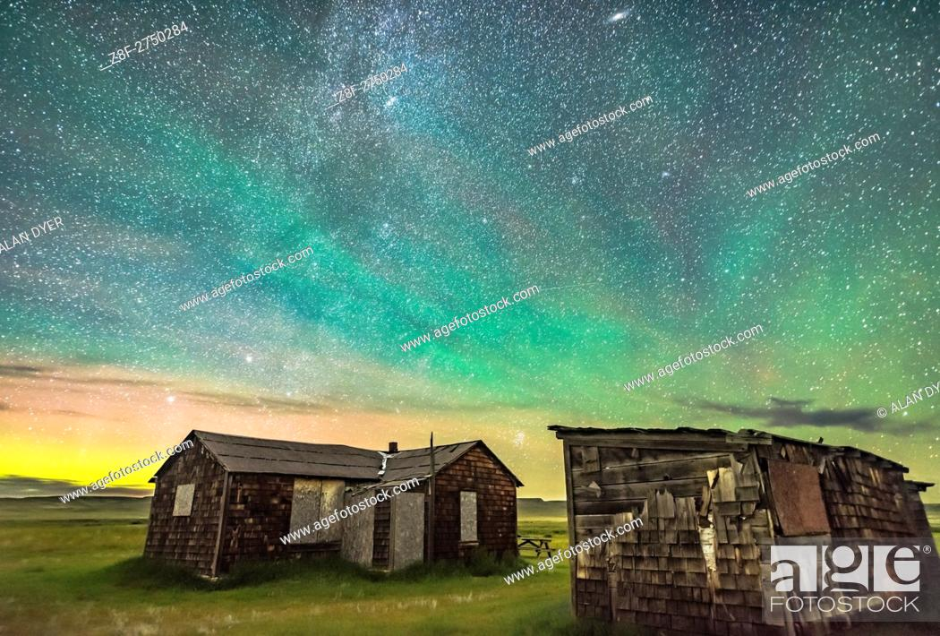 Stock Photo: The Pleiades rising behind the rustic cabins and outbuildings of the historic Larson Ranch in Grasslands National Park, Saskatchewan.