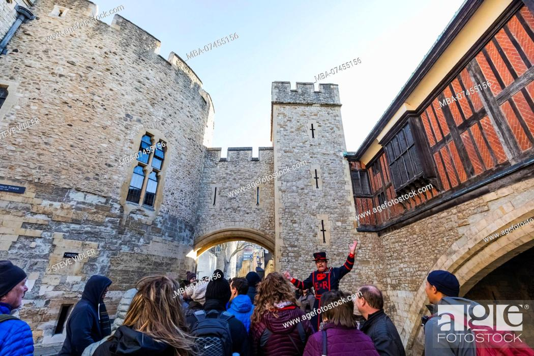 Stock Photo: England, London, Tower of London, Beefeater and Tour Group.