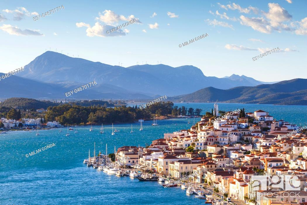 Stock Photo: View of Poros island and mountains of Peloponnese peninsula in Greece. .