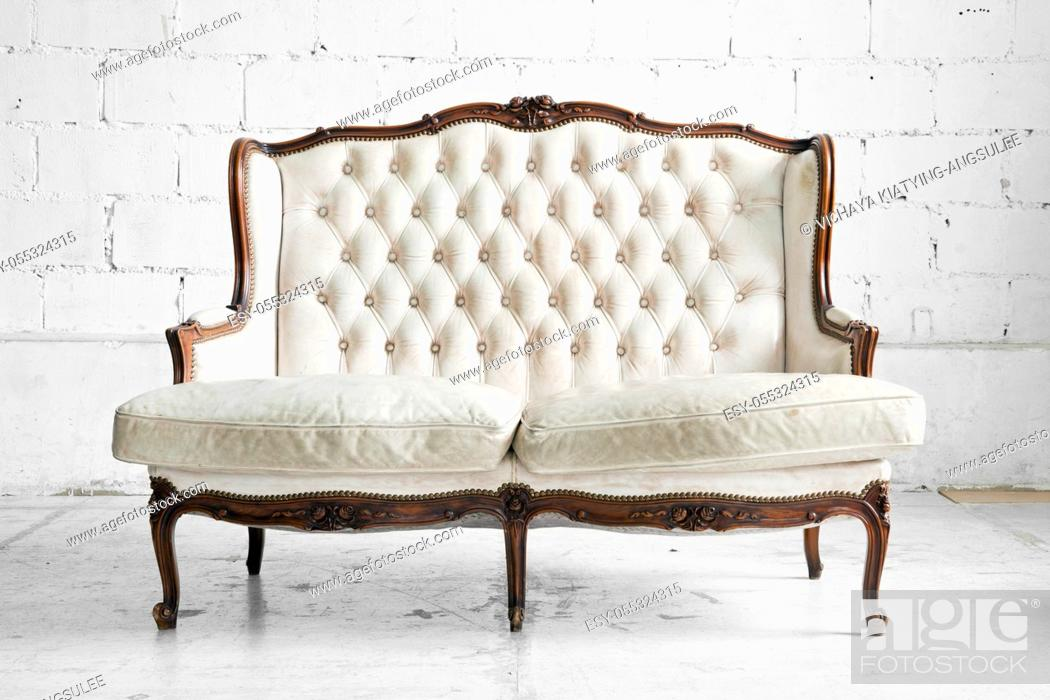 Stock Photo: White genuine leather classical style sofa in vintage room.