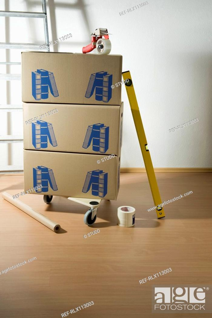 Stock Photo: Pile of Cardboard Boxes and ladder.