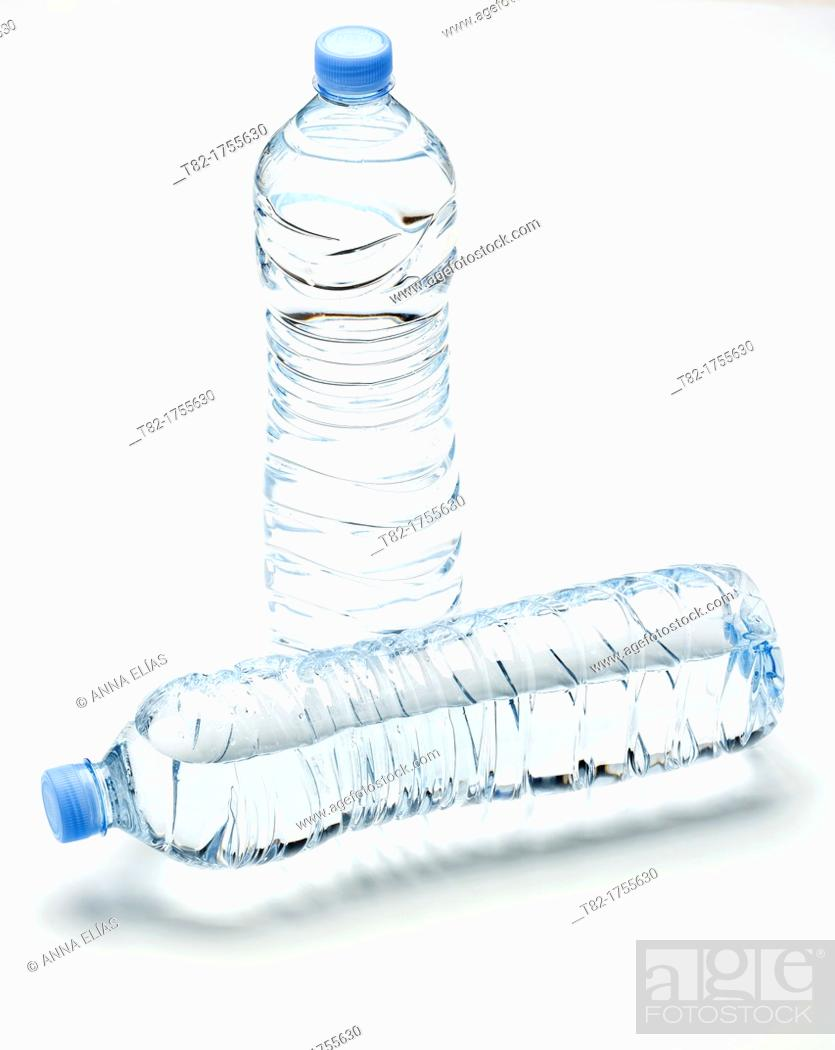 Stock Photo: two plastic bottles unlabeled full of mineral water on white background.