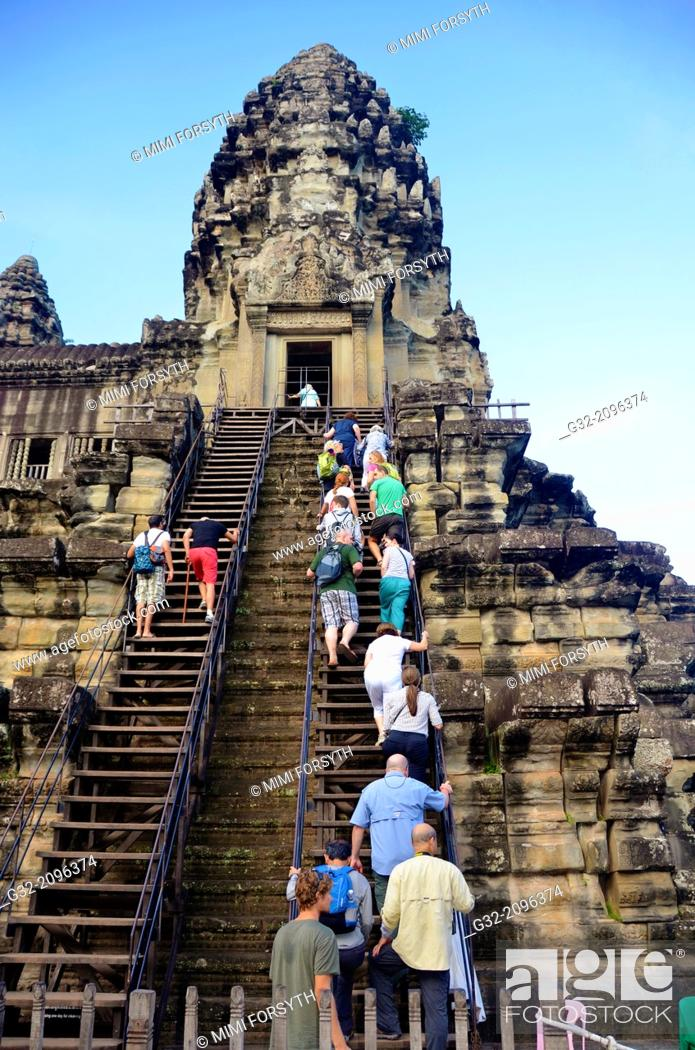 Stock Photo: People climb to level 2 to sightsee, Angkor Wat, Cambodia.