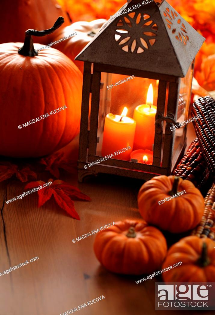 Photo de stock: Lanterns with burning candles and pumpkins.