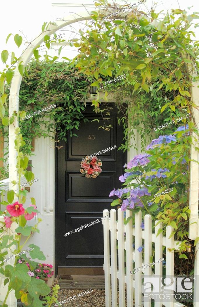 Stock Photo: Flowers around front door.