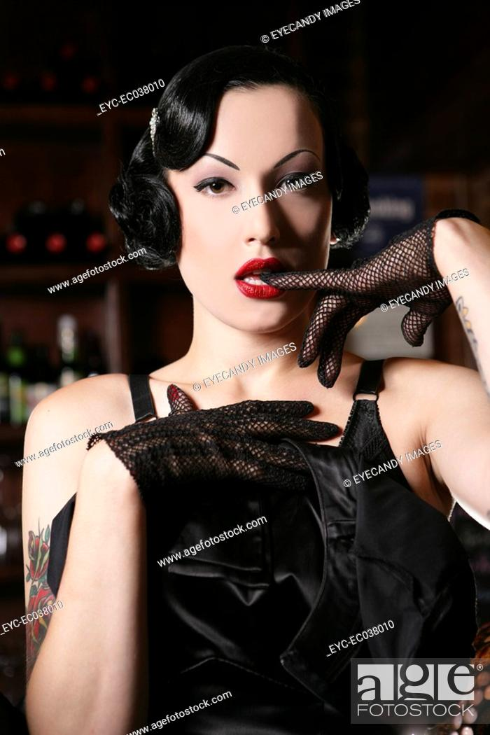 Stock Photo: Young sexy woman in burlesque bar.