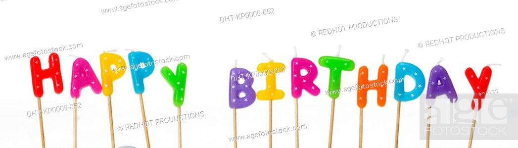 Stock Photo: Coloured letter Candles spelling out Happy Birthday.