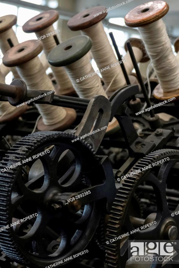 Stock Photo: Spools of wool on industrial revolution textile machinery, Bradford, England, UK.