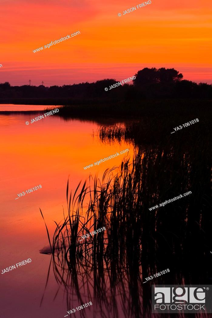 Stock Photo: England, Tyne and Wear, Big Waters County Park  Sunset over the lake in Big Waters Country Park The lake is a a subsidence pond.