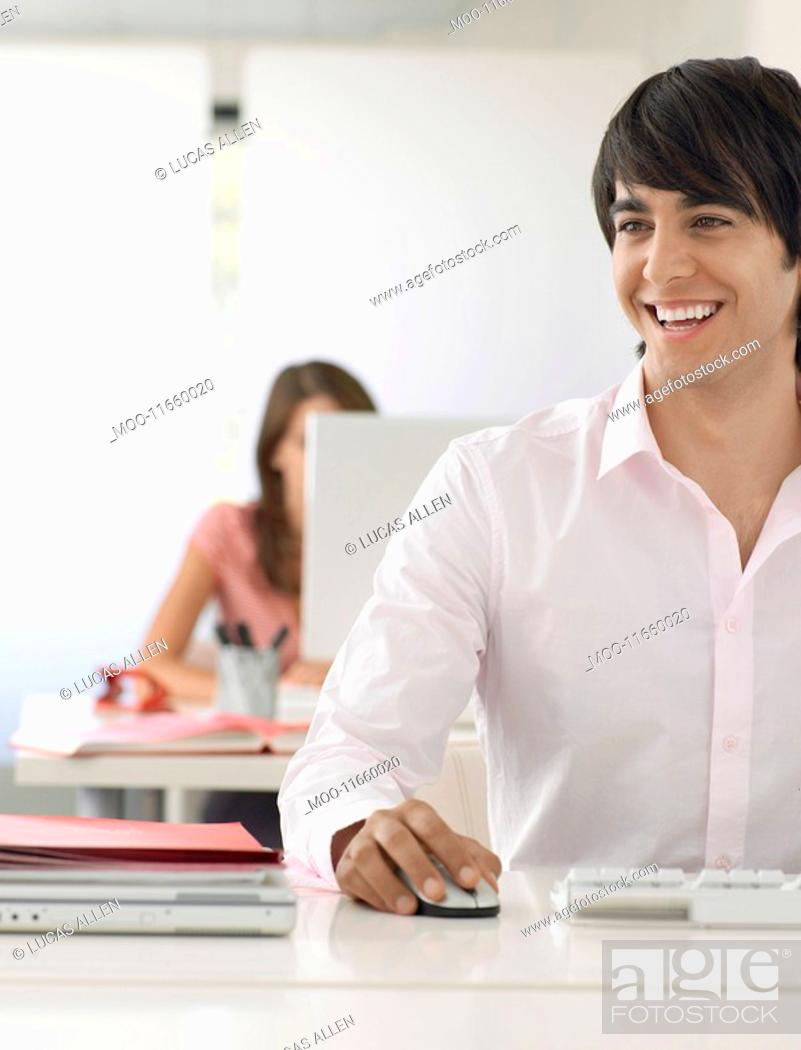 Stock Photo: Business man at desk.