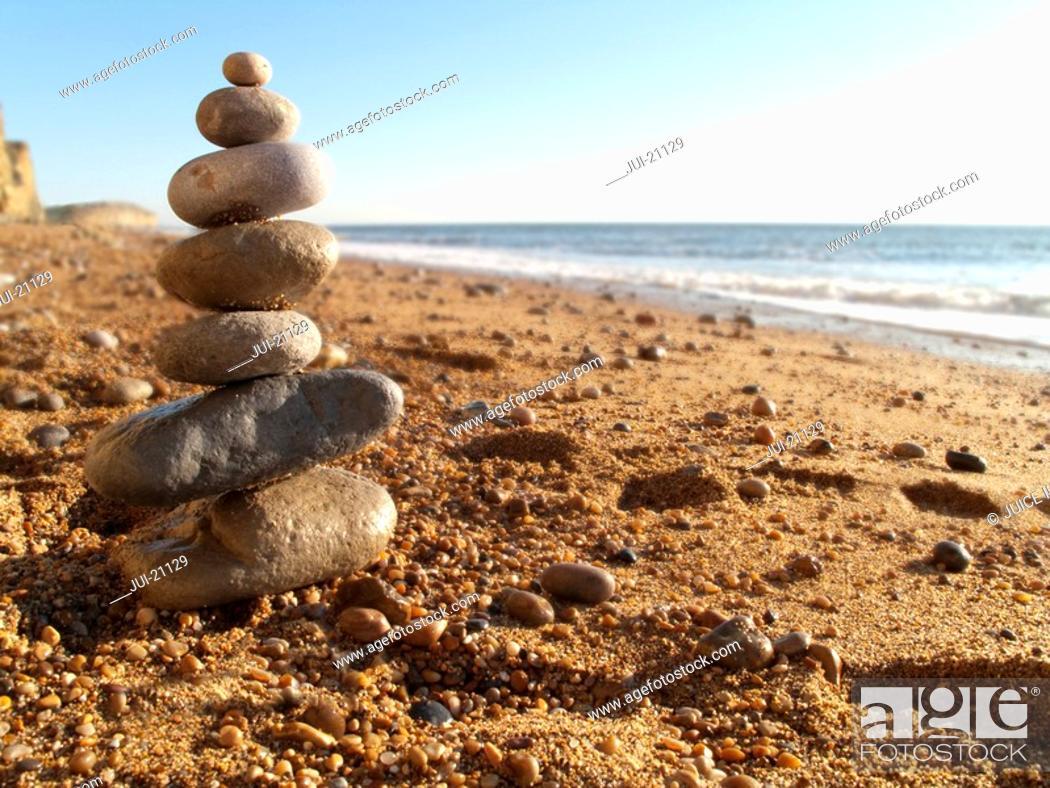 Stock Photo: Rock cairn on beach.