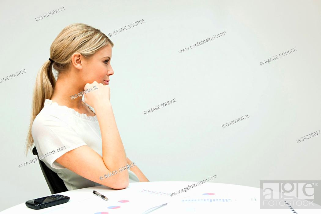 Stock Photo: Portrait of businesswoman at table.