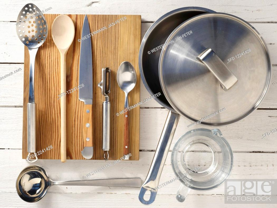 Stock Photo: Kitchen utensils for making steamed wolf fish fillets with julienne vegetables.