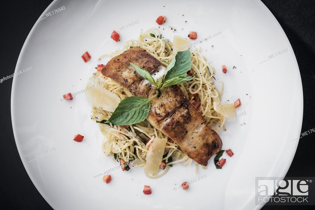 Stock Photo: fresh cod fish fillet on mixed vegetable and parmesan spaghetti pasta.