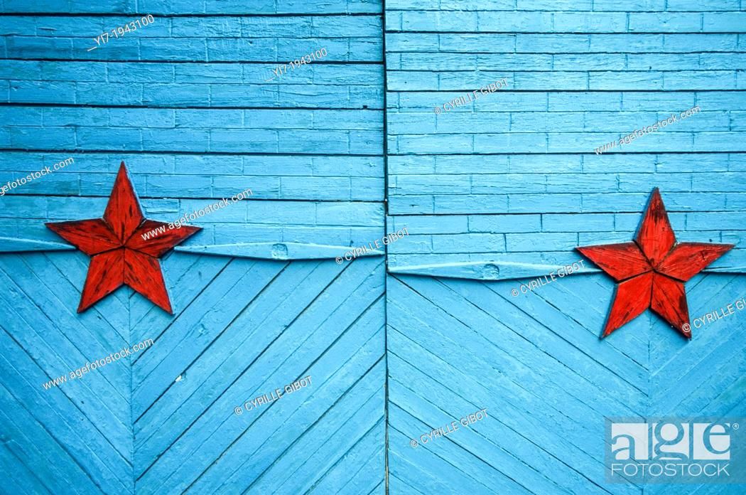 Stock Photo: Blue painted door with red stars, Karakol, Kyrgyzstan, Central Asia.