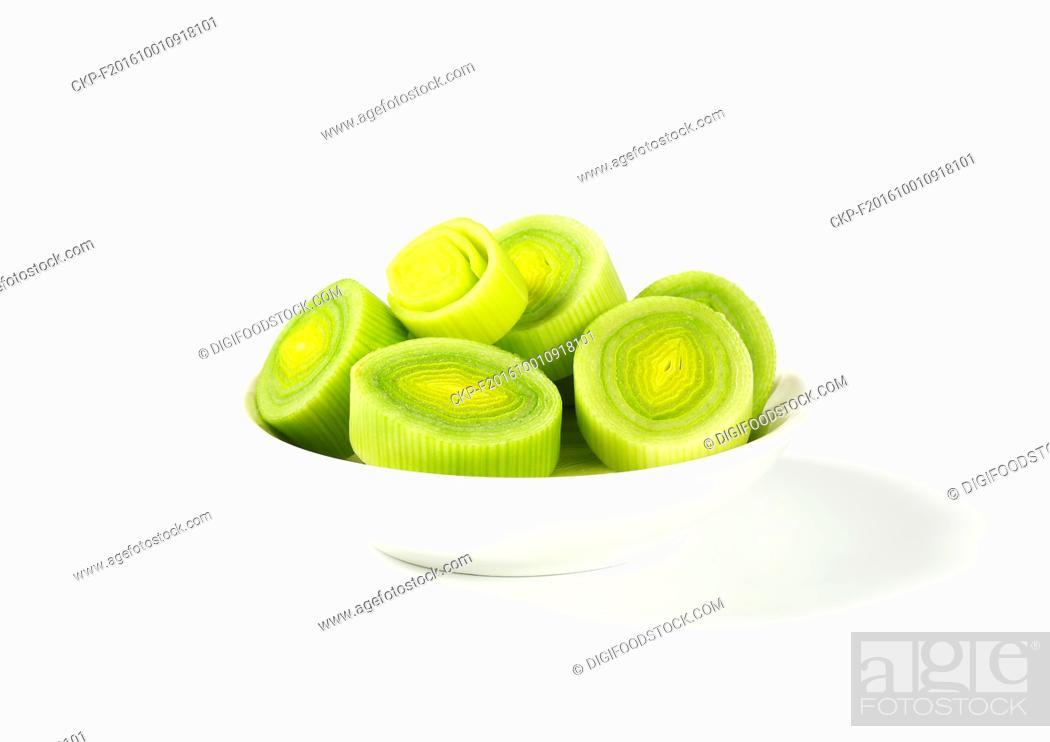 Stock Photo: chopped fresh leek in white bowl.