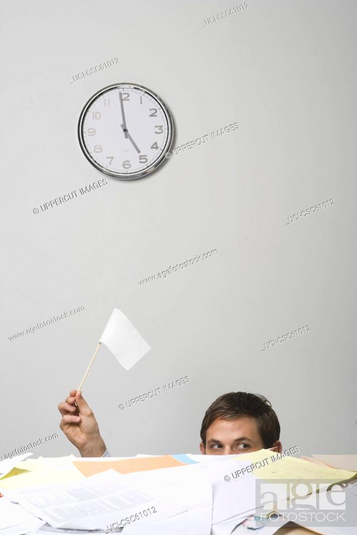 Stock Photo: Businessman waving white flag.