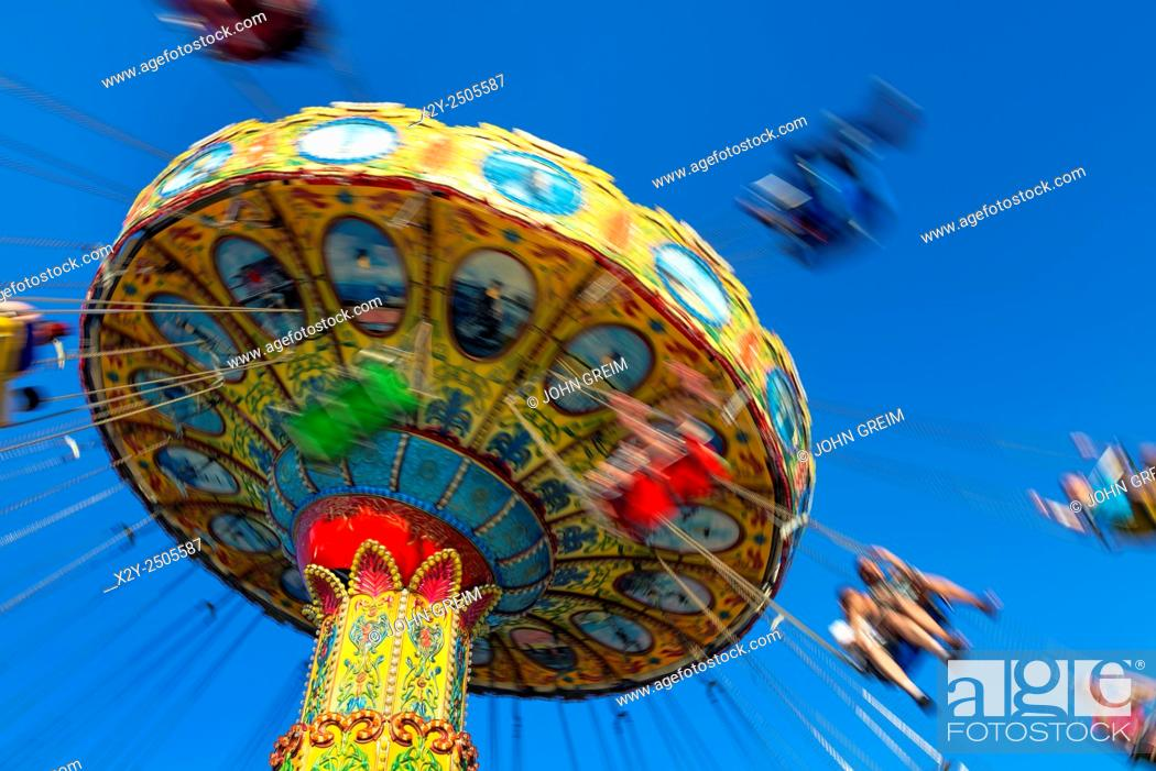 Stock Photo: Blurred carousel ride at an amusement park.