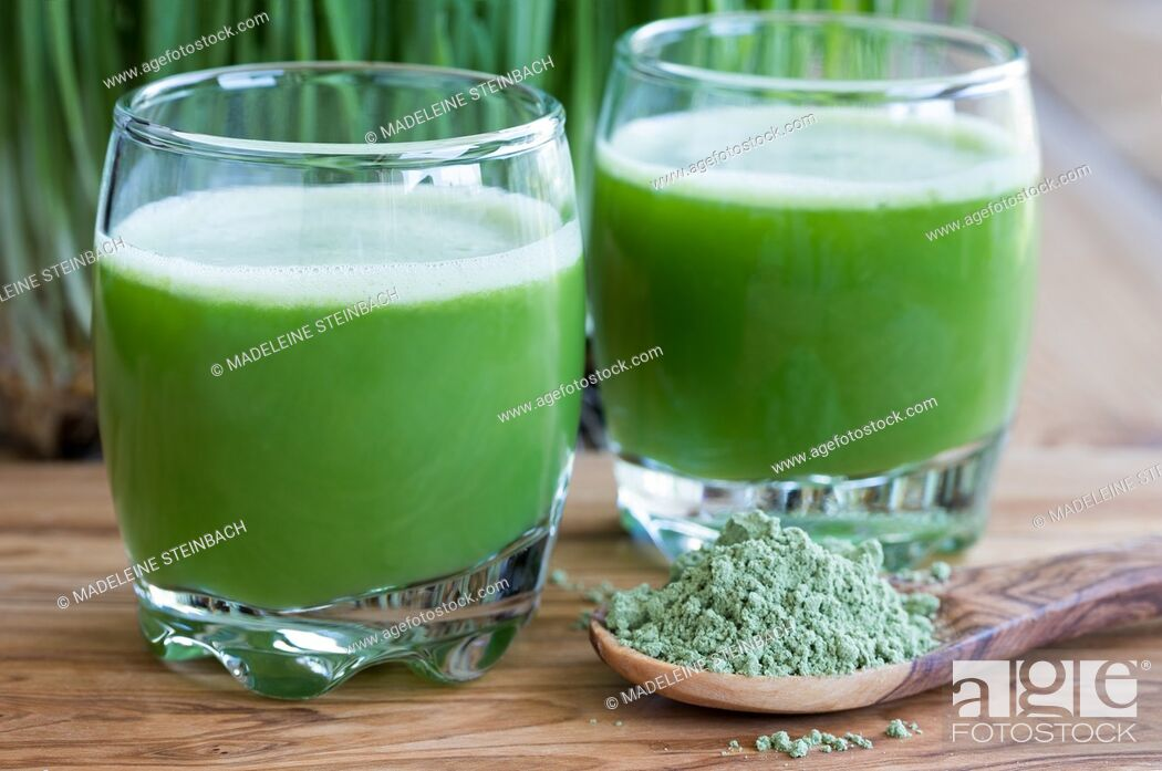 Stock Photo: Two shots of fresh barley grass juice, with barley grass powder in the foreground.
