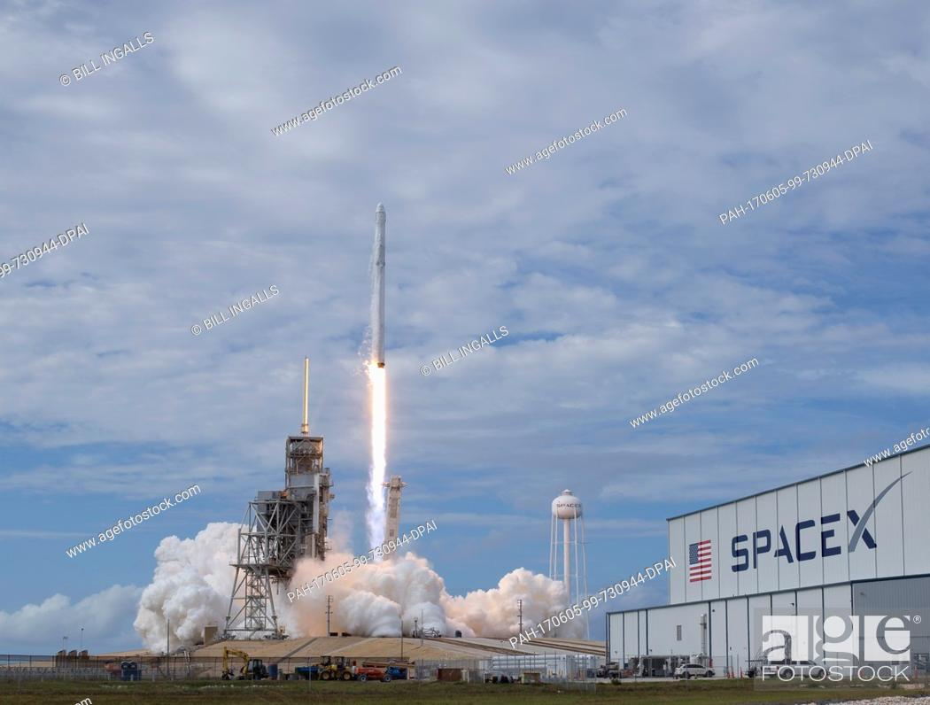 Stock Photo: The SpaceX Falcon 9 rocket, with the Dragon spacecraft onboard, launches from pad 39A at NASA·s Kennedy Space Center in Cape Canaveral, Florida, Saturday.