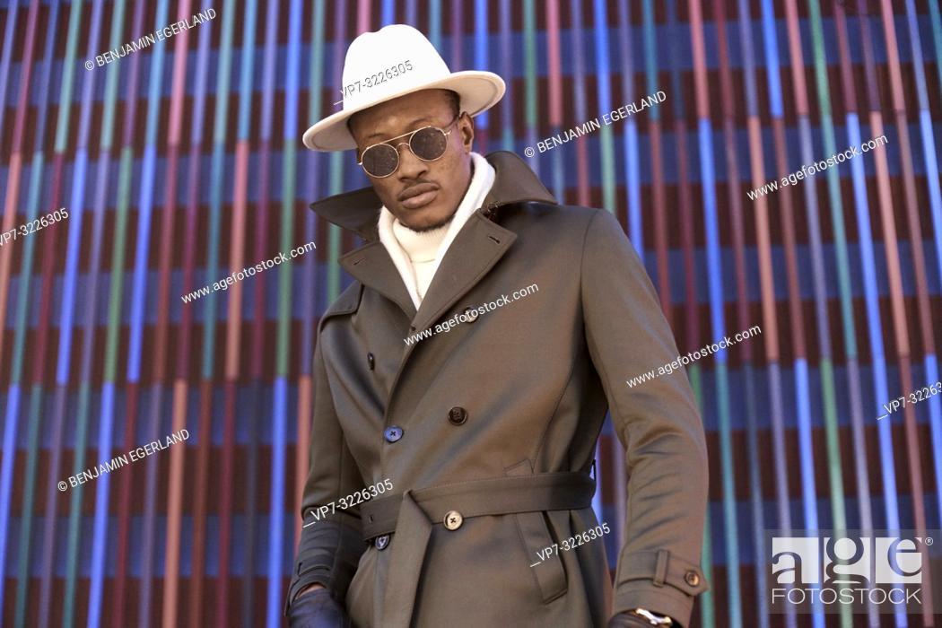 Stock Photo: fashionable stylish blogger man wearing sunglasses and hat, in Munich, Germany.