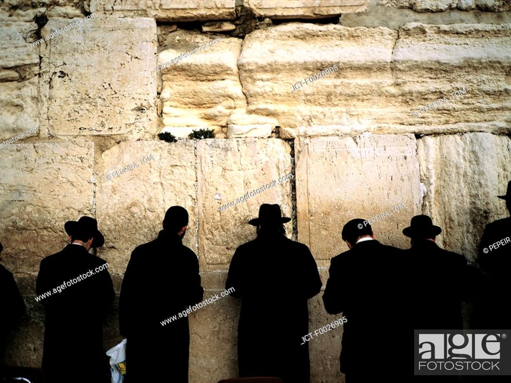 Stock Photo: Israel, Jerusalem, praying jews in front of the Western Wall.