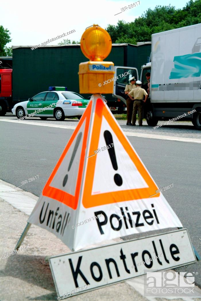 Stock Photo: DEU, Germany, NRW: Controll of trucks at the highway A4 near Cologne. The police officers check the security of the cargo, the saftey of the trucks and drivers.