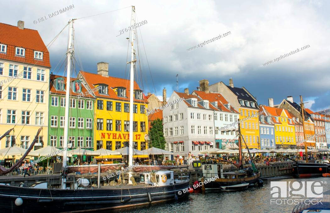 Stock Photo: Copenhagen Denmark famous Nyhavn color homes and boats with crowds Kobenhavn tourists.