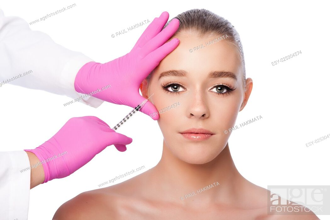 Stock Photo: Beautiful face crows feet injection Cosmetic skincare spa beauty treatment with pink gloves by eye, on white.