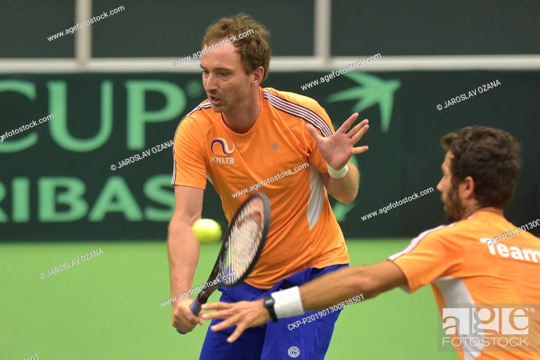 Stock Photo: Netherland's Matwe Middelkoop, left, and Jean-Julien Rojer play a ball during a training session in Ostrava, Czech Republic, January 30, 2019.