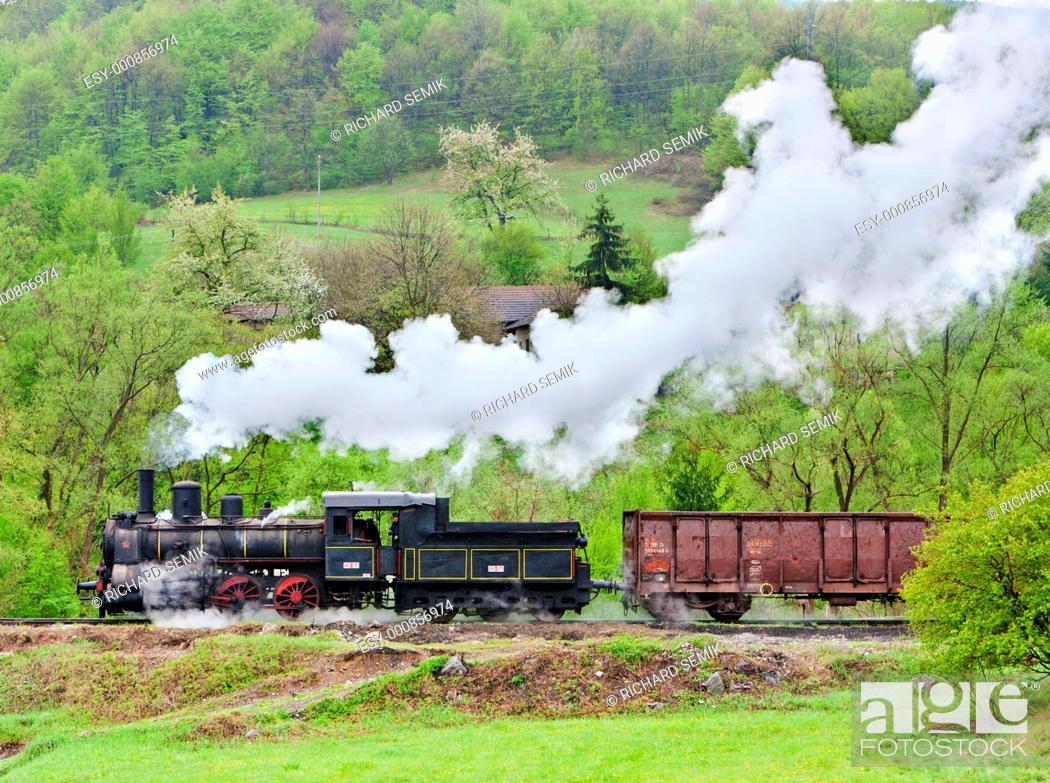 Stock Photo: steam freight train 126 014, Resavica, Serbia.