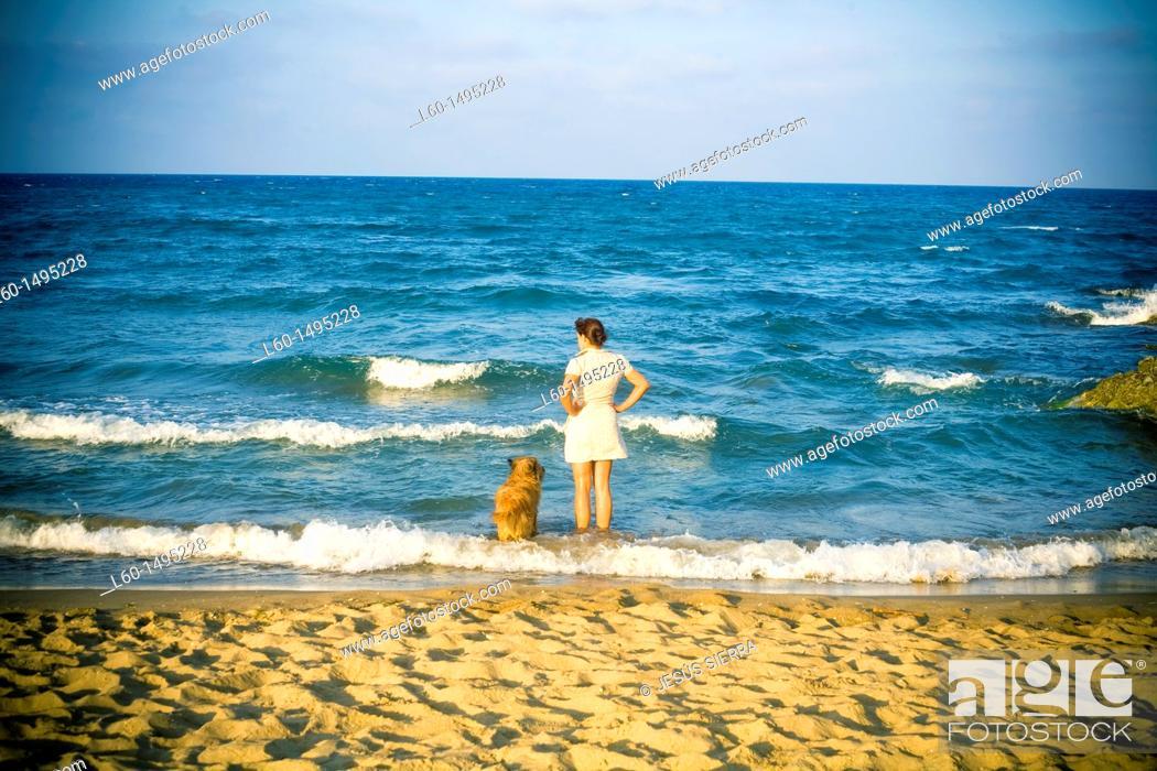 Stock Photo: Woman and dog  Cabo de Gata, Almeria, Spain.