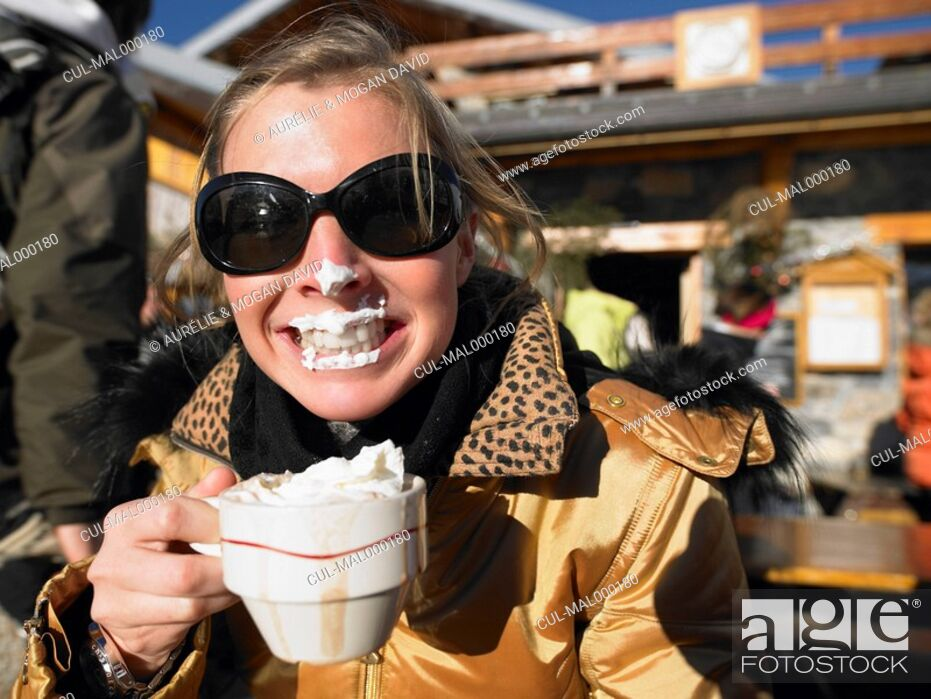 Stock Photo: Young woman with whipped cream on lips.