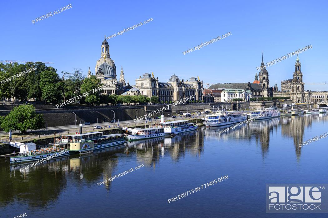 Stock Photo: 13 July 2020, Saxony, Dresden: View of the historical old town scenery with the dome of the academy of arts (l-r), the Frauenkirche, the academy of arts.