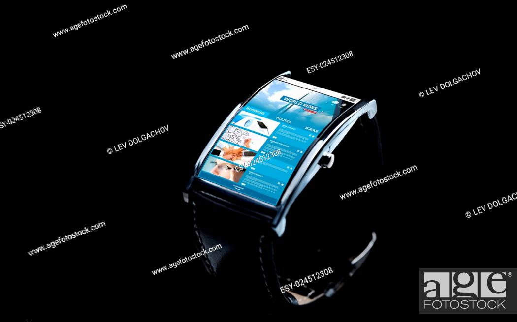 Stock Photo: modern technology, mass media, object and media concept - close up of black smart watch with business news on screen.