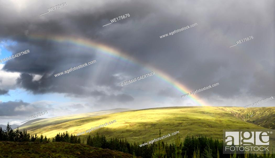 Stock Photo: Double rainbow and dark clouds on An Liathanach mountain at Loch a Chroisg near Badavanich Scottish Highlands Scotland UK.