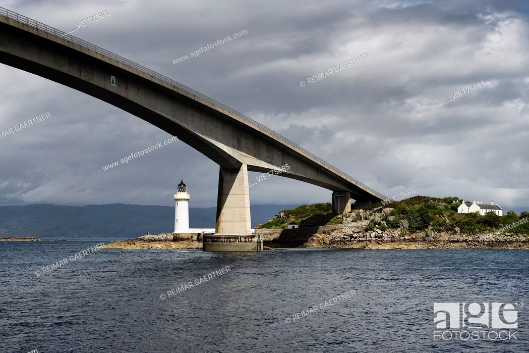 Stock Photo: Skye Bridge over Kyle Akin Strait from Inner Sound to Loch Alsh and Eilean Ban Island with white Kyleakin lighthouse and cottages Scotland.