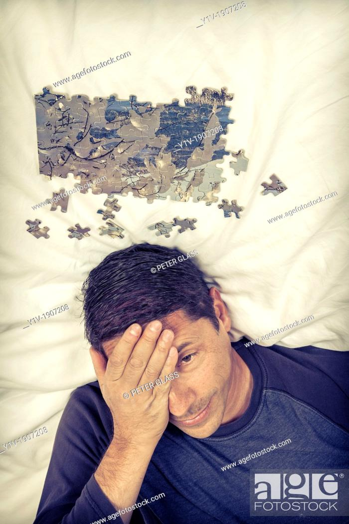 Stock Photo: Middle-age man with a puzzle.