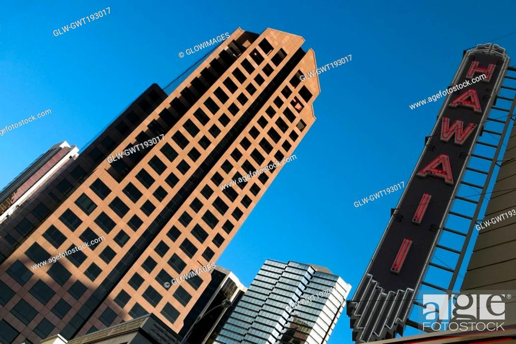 Stock Photo: Low angle view of skyscrapers in a city, Honolulu, Oahu, Hawaii Islands, USA.