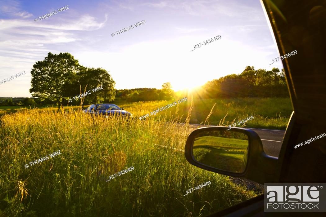Stock Photo: Car on a bright sunny day in the countryside. Stuttgart, Germany.