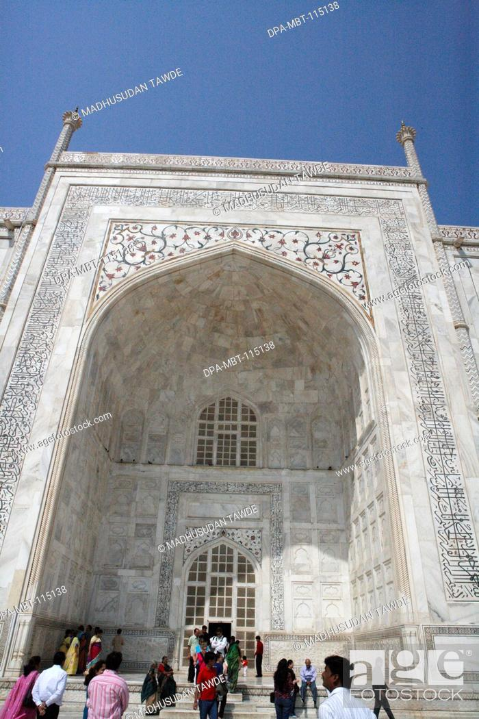 Stock Photo: Huge arch of Taj Mahal Seventh Wonders of World on the south bank of Yamuna river , Agra , Uttar Pradesh , India UNESCO World Heritage Site.