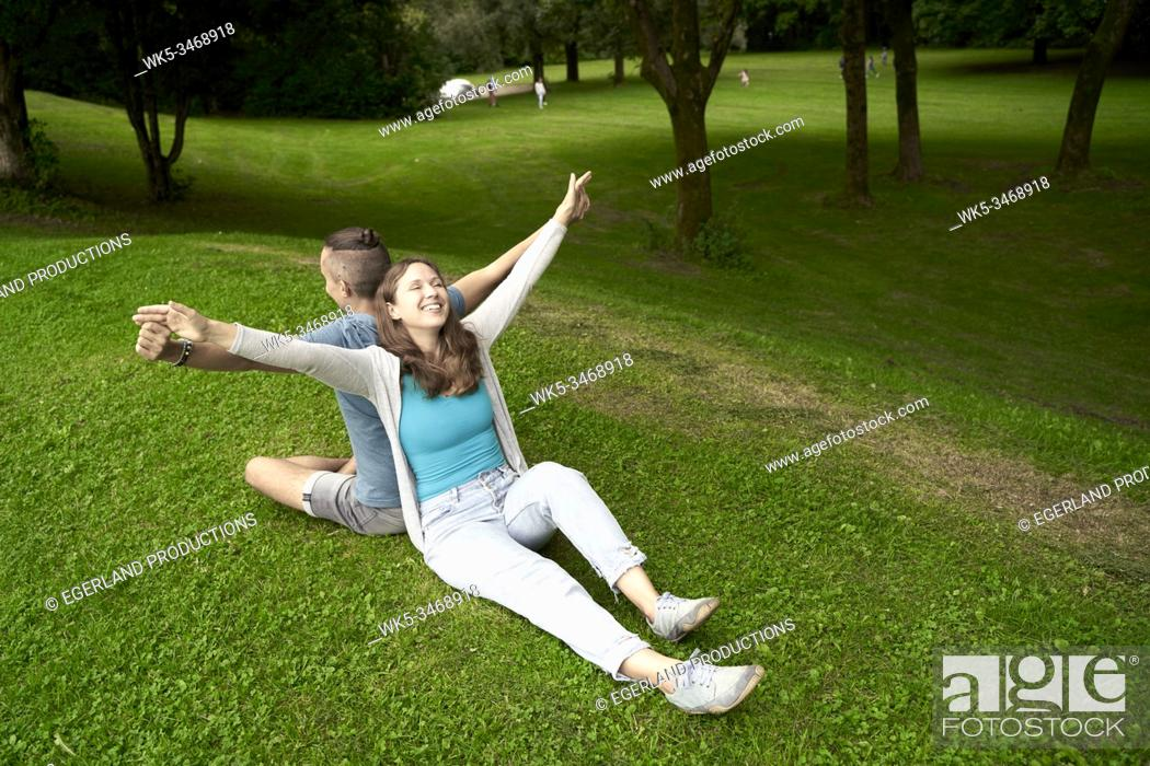 Stock Photo: Happy couple in park. Munich, Germany.